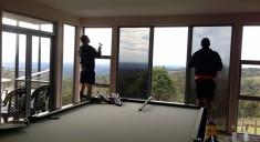 technicians applying window film - window tinting gold coast